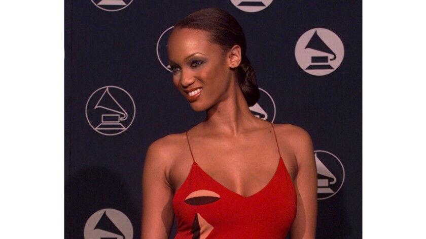 Tyra Banks, a top model of the 1990s who went on to TV reality fame, is shown at the '97 Grammy Awards