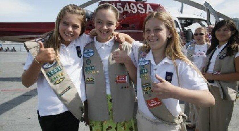 From left, Girl Scouts Melissa Thomas of Rancho Santa Fe (3,009 boxes), Caroline Sanborn of Carmel Valley (2,012 boxes) and Roni Nelson of Rancho Santa Fe (4,082 boxes).