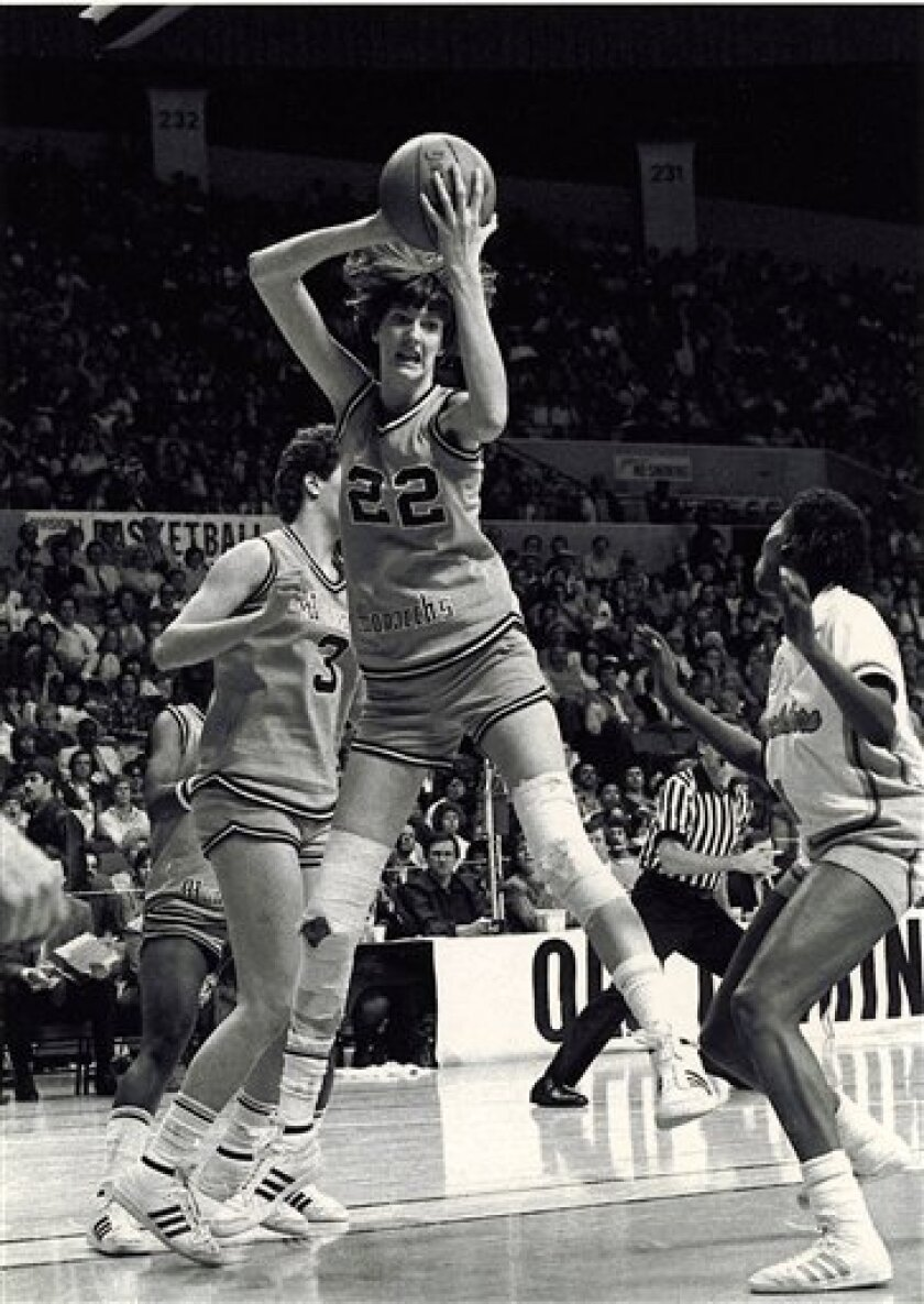 This undated photo shows Old Dominion University women's basketball player Anne Donovan (22) grabbing the ball. Long before Brittney Griner was swatting away shots for top-ranked Baylor, there was another 6-foot-8 women's college player getting blocks at a record pace. Donovan even had more blocked shots that Griner's NCAA-recognized record for men or women. (AP Photo/The Virginian-Pilot) MAGS OUT