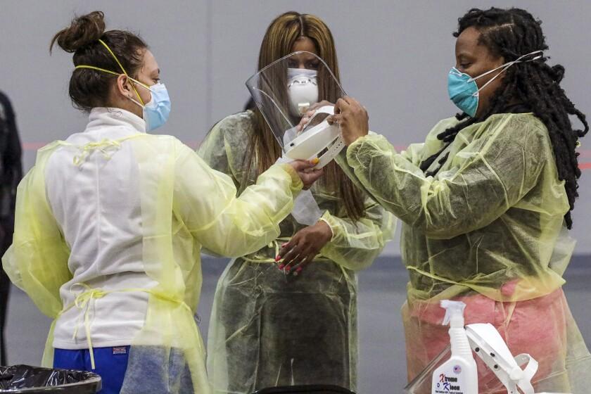 Nurses get ready as San Bernardino County activates the mass-vaccination site on Thursday at the Ontario Convention Center.