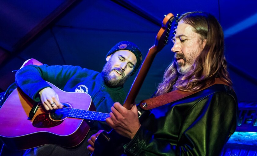 San Diego-bred musicians Kellen Asebroek (left) and Tyler Grant are returning to Winstons in Ocean Beach for their sixth annual holiday concert.