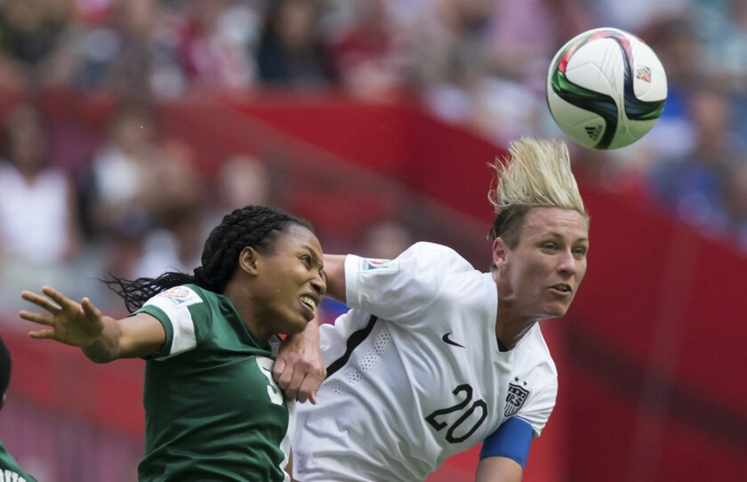 """FILE - In this June 16, 2015, file photo, Nigeria's Onome Ebi, left, and United States' Abby Wambach vie for the ball during a FIFA Women's World Cup soccer game in Vancouver, British Columbia, Canada. With the title match looming, Wambach isn't mincing words. """"All I care about is winning this Worl"""