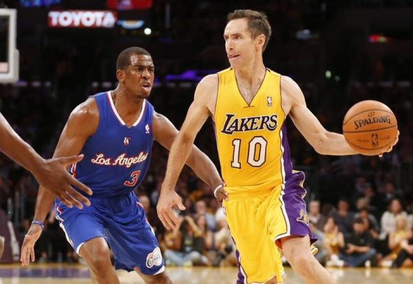 Lakers point guard Steve Nash makes a pass in front of Clippers guard Chris Paul during last month's season opener. Back pain forced Nash to miss the second half of Sunday's loss to the Minnesota Timberwolves.