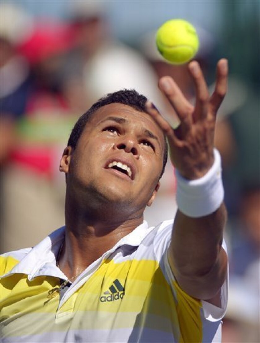 Jo-Wilfried Tsonga, of France, tosses the ball on a serve to Milos Raonic, of Canada, at the BNP Paribas Open tennis tournament, Wednesday, March 13, 2013, in Indian Wells, Calif. (AP Photo/Mark J. Terrill)