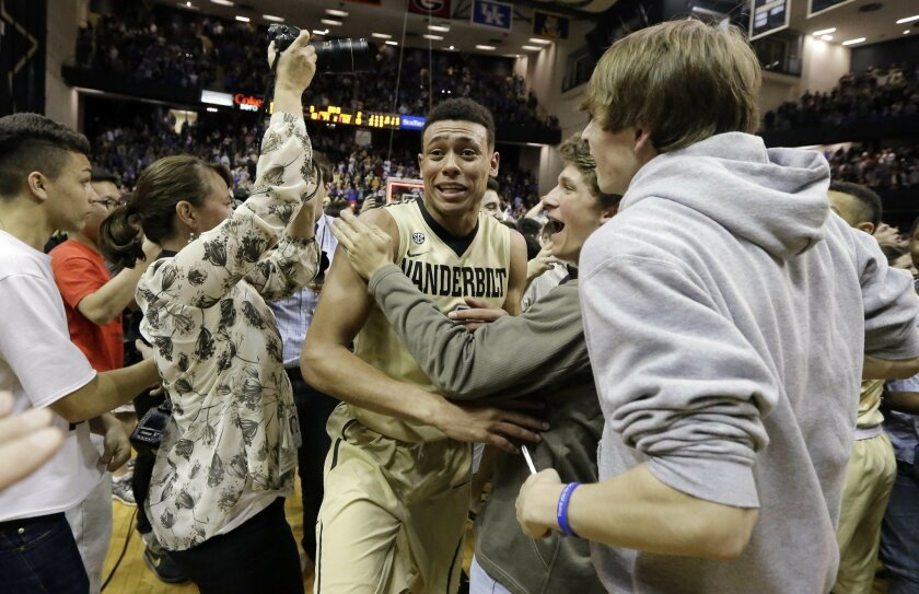 Vanderbilt guard Wade Baldwin IV makes his way through celebrating fans after Vanderbilt upset No. 16 Kentucky 74-62 in an NCAA college basketball game Saturday, Feb. 27, 2016, in Nashville, Tenn. (AP Photo/Mark Humphrey)
