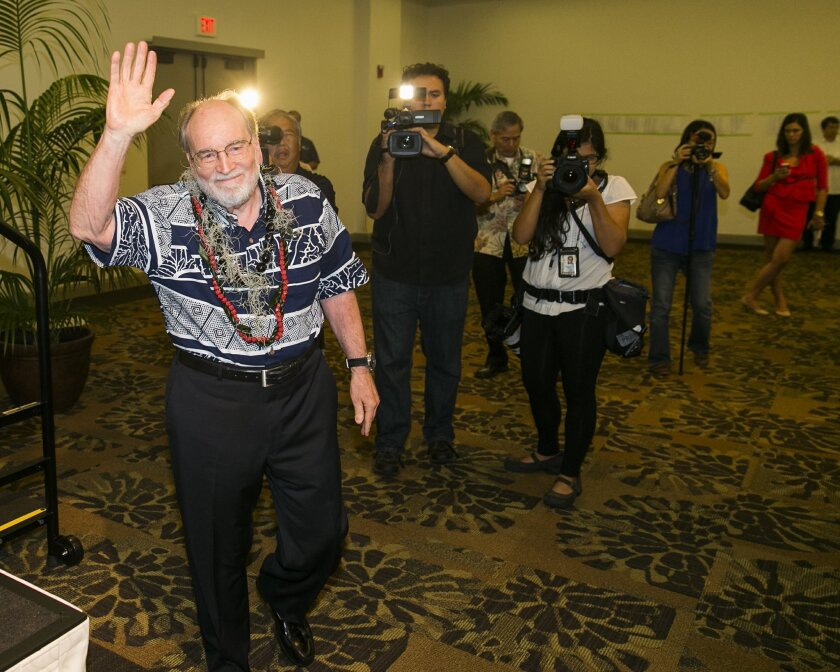 Hawaii Gov. Neil Abercrombie, center, waves to the crowds at the Democratic Unity Breakfast, Sunday, Aug. 10, 2014 in Honolulu. The breakfast is traditionally held after Hawaii elections and is attended by both winners as well as losers. Fellow Democrat and State Sen. David Ige defeated Abercrombie in a stunning primary-election defeat Saturday. (AP Photo/Marco Garcia)