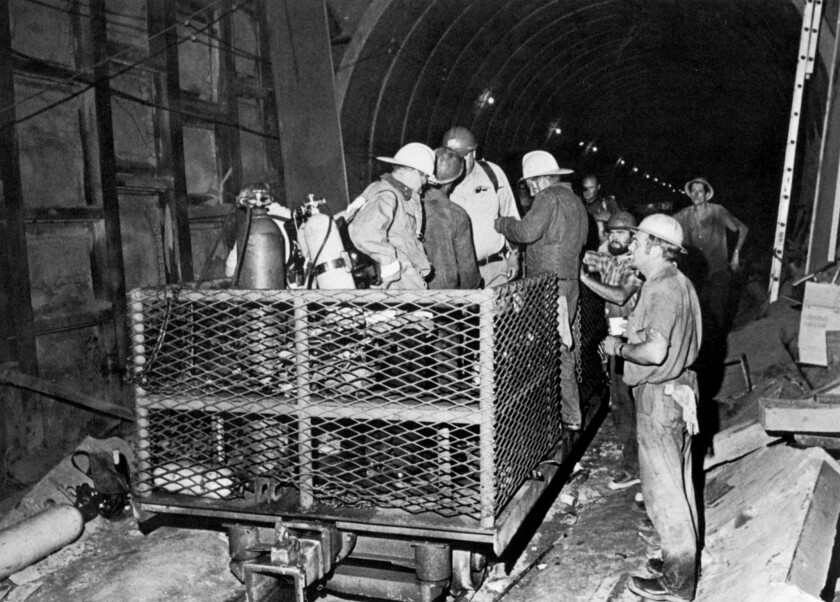 Workers and firemen in a Metropolitan Water District tunnel in Sylmar in 1971.