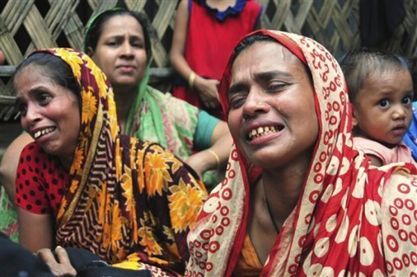 Bangladeshi women cry after a vehicle packed with schoolchildren returning home from a soccer tournament crashed into a canal in Chittagong district, 216 kilometers (136 miles) southeast of Dhaka, Bangladesh, Monday, July 11, 2011. Tens of people died and the toll may rise, police said. (AP Photo)