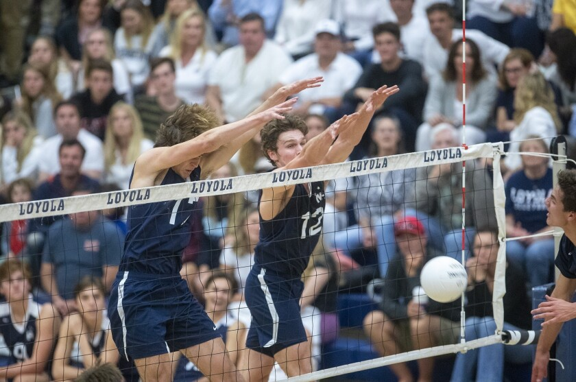 Newport Harbor's Alec Patterson, left, and and Dayne Chalmers block a hit during a CIF Southern Sect
