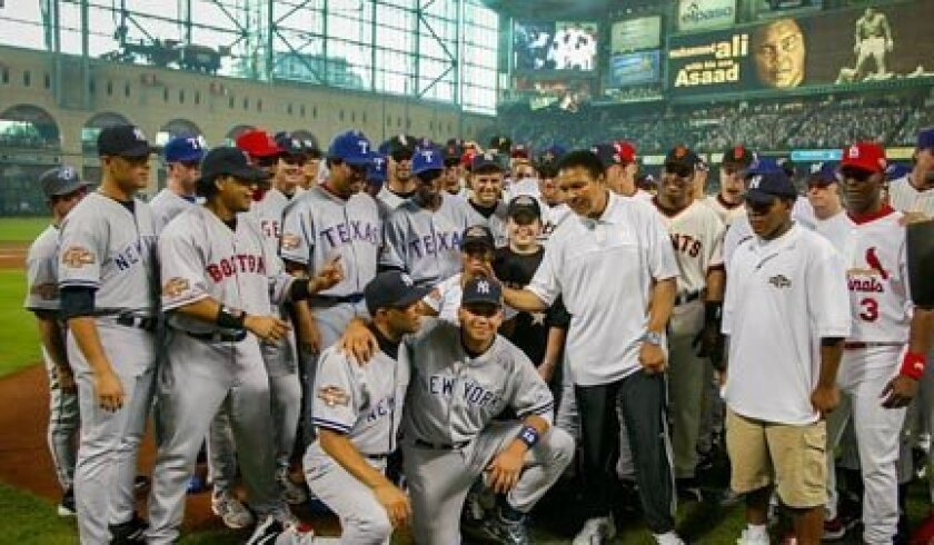 Members of the 2004 NL and AL All-Star teams pose with Muhammad Ali before the game played at Houston's Minute Maid Field.