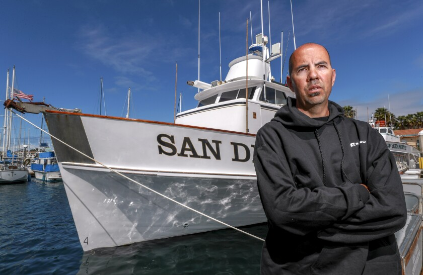 Ryan Bostian, owner and captain of the San Diego, stands next to the San Diego at Mission Bay.