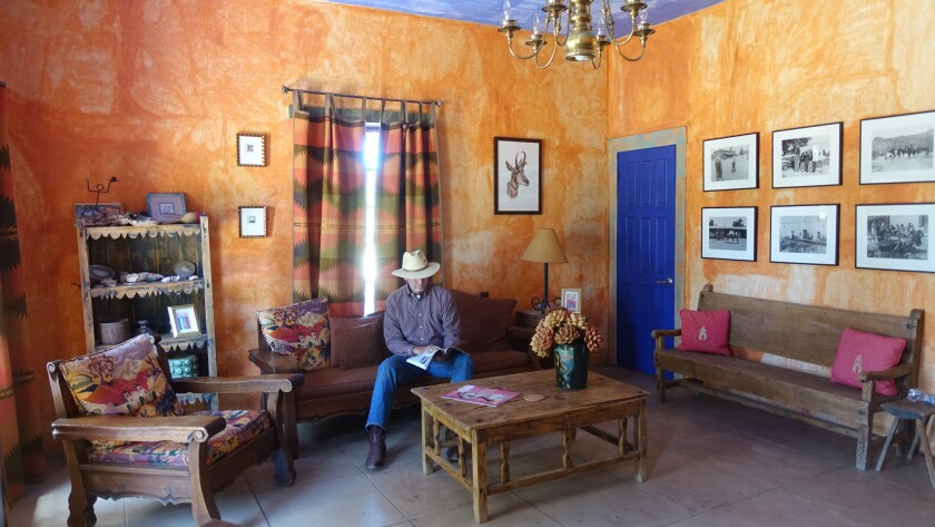 A guest learns about the 100+ year history of Rancho de la Osa in the Hacienda, the original owners