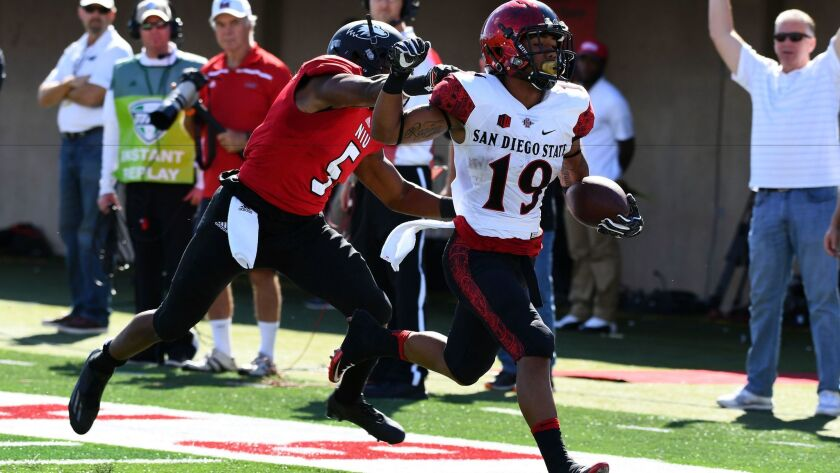 San Diego State Aztecs running back Donnel Pumphrey (19) rushes for a touchdown against the Northern Illinois Huskies during the first quarter at Huskie Stadium.
