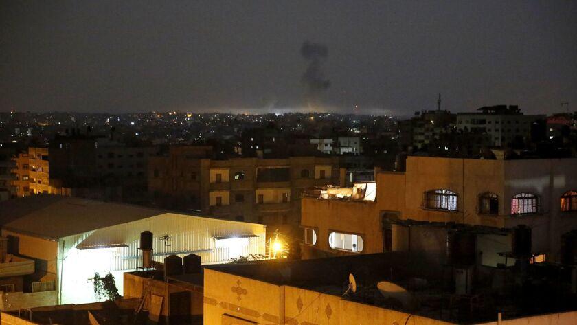 Smoke rises following an Israeli strikes on Gaza City, early Wednesday, May 30, 2018. Palestinian mi