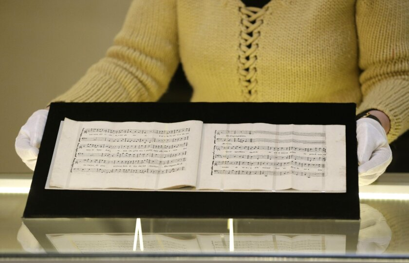 """A recently discovered piece of music composed jointly by Wolfgang Amadeus Mozart and Antonio Salieri, and an unknown composer Cornetti that was considered lost for more than 200 years is presented at the Czech Museum of Music in Prague, Czech Republic, Tuesday, Feb. 16, 2016. Cantata """"Per la Ricupe"""