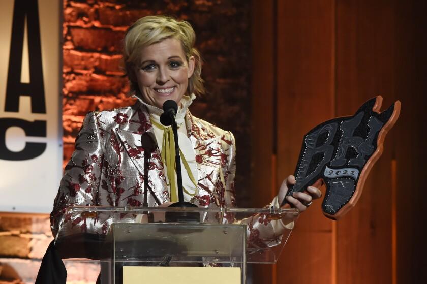 Brandi Carlile accepts the artist of the year award at the Americana Honors & Awards show Wednesday, Sept. 22, 2021, in Nashville, Tenn. (AP Photo/Mark Zaleski)