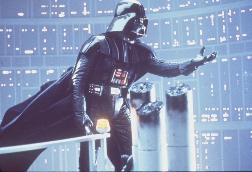 "Darth Vader beckons to Luke Skywalker in 1980's ""Star Wars: Episode V — The Empire Strikes Back."""