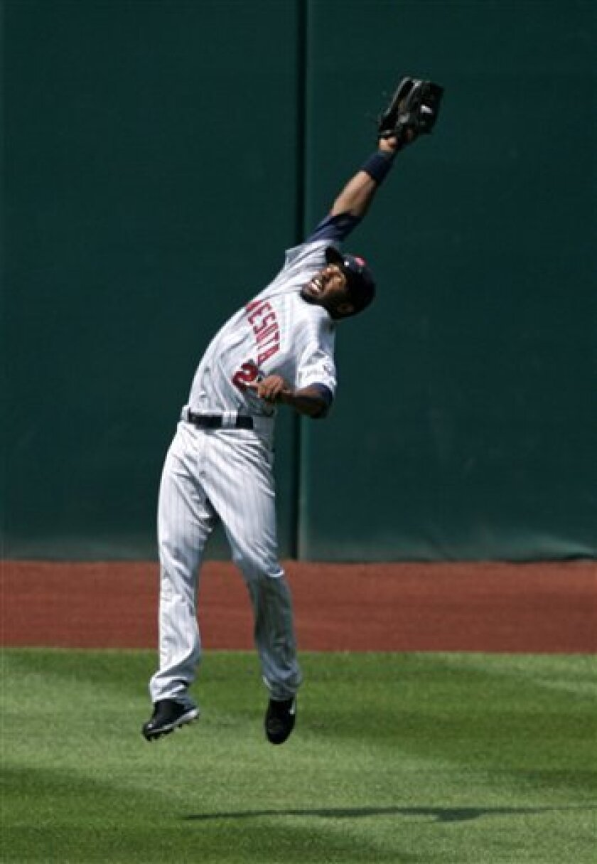 Minnesota Twins center fielder Denard Span catches a fly ball hit by Cleveland Indians' Andy Marte in the fourth inning in a baseball game, Sunday, July 27, 2008, in Cleveland. Marte was out. (AP Photo/Tony Dejak)