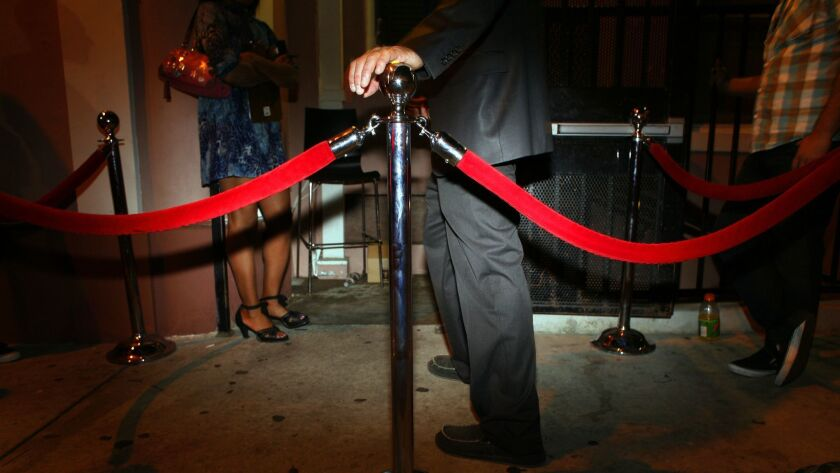 A red rope outside a Hollywood nightclub hints at exclusivity.