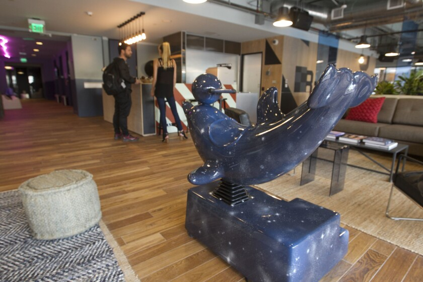 Unique San Diego icons appear throughout the WeWork space, such as this sculpture of a bit of local ocean lore.