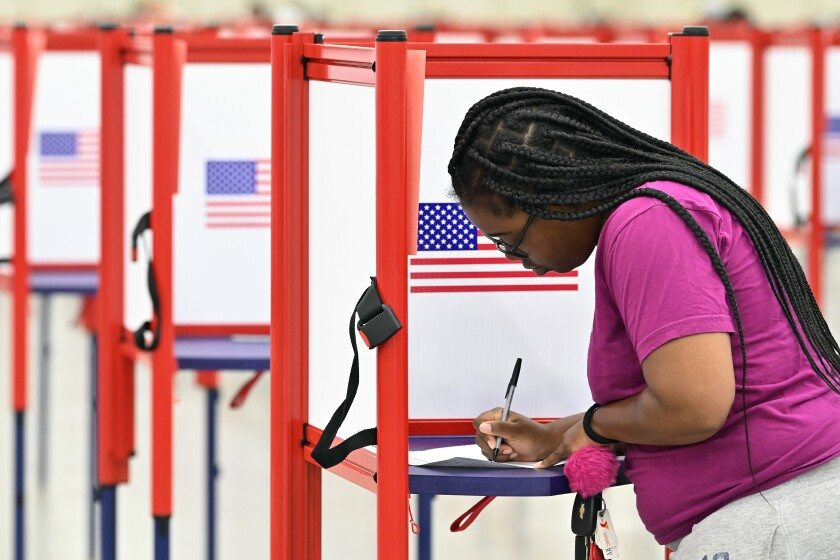 A voter fills out a  ballot in Louisville, Ky.