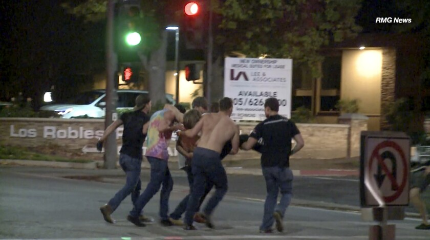 In this image taken from video a victim is carried from the scene of a shooting, Wednesday evening,