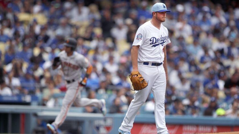 LOS ANGELES, CALIF. -- SUNDAY, JUNE 17, 2018: Dodgers pitcher Caleb Ferguson looks away as Giants