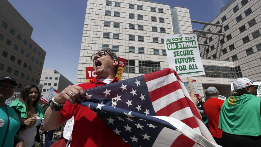 Labor union members in a protest outside the Ronald Reagan Medical Center at UCLA on May 8.
