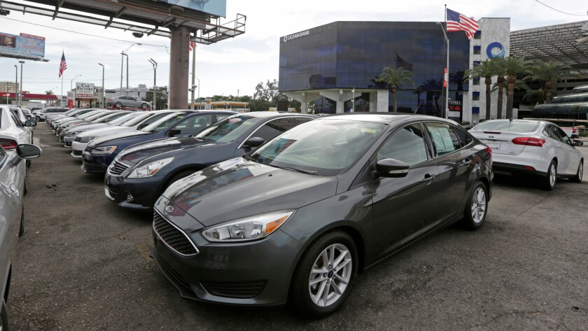 FILE- In this Jan. 17, 2017, file photo, certified pre-owned vehicles sit on display at an auto deal