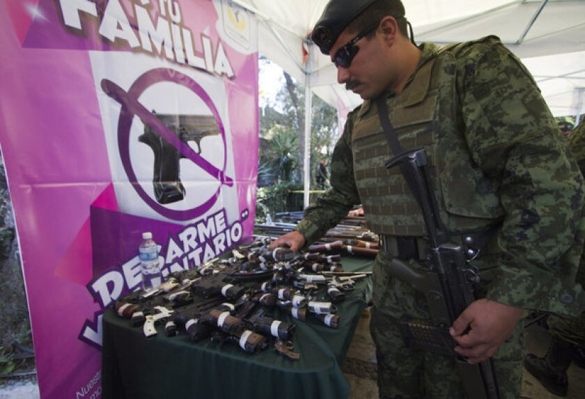 In crime-toughened Mexico City, cash-for-weapons exchange extended