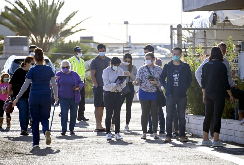 People line up for free COVID-19 testing at the San Diego County testing site on Linda Vista Rd. in San Diego.