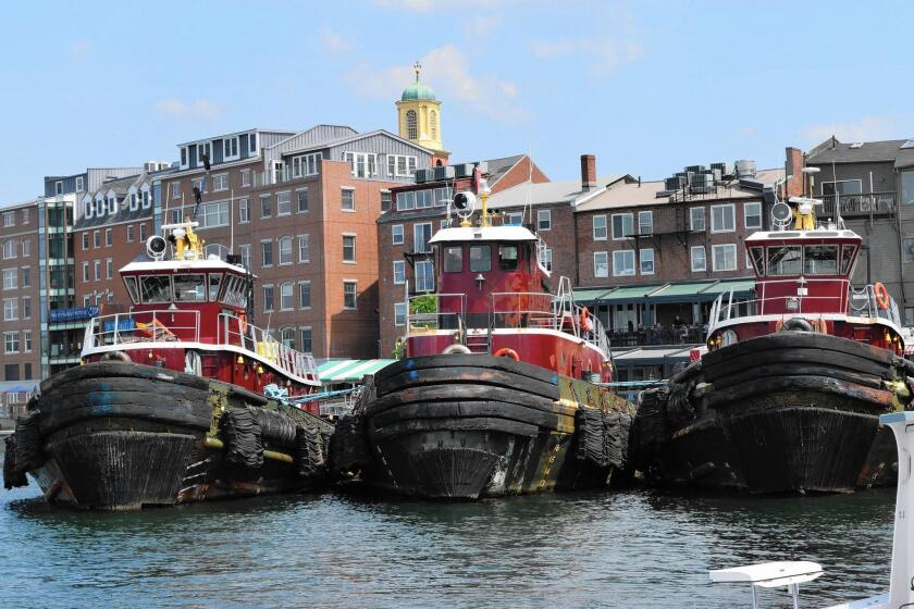 Moored in the harbor, the Moran tugboats add to Portsmouth's seacoast appeal.