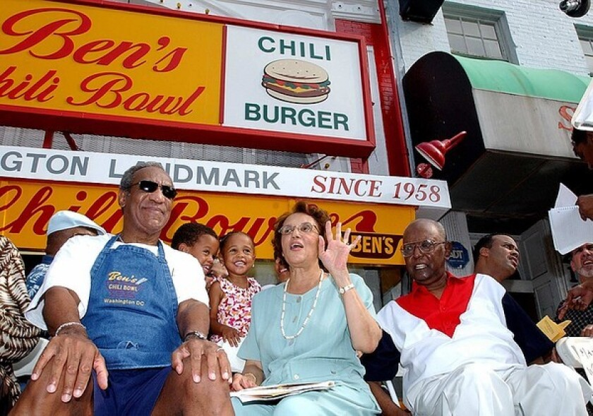 Ben Ali, right, and his wife, Virginia, are joined by comedian Bill Cosby during Ben's Chili Bowl's 45th anniversary celebration.
