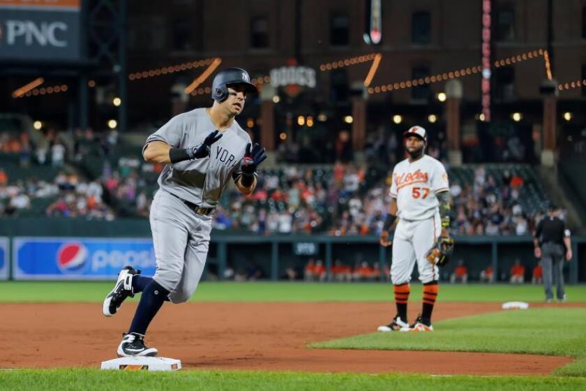 New York Yankees center fielder Mike Tauchman (L) rounds third base after hitting a solo home against the Baltimore Orioles in the third inning of the MLB baseball game between the Baltimore Orioles and the New York Yankees at Oriole Park at Camden Yards in Baltimore, Maryland, USA, 06 August 2019. EFE/Erik S. Lesser