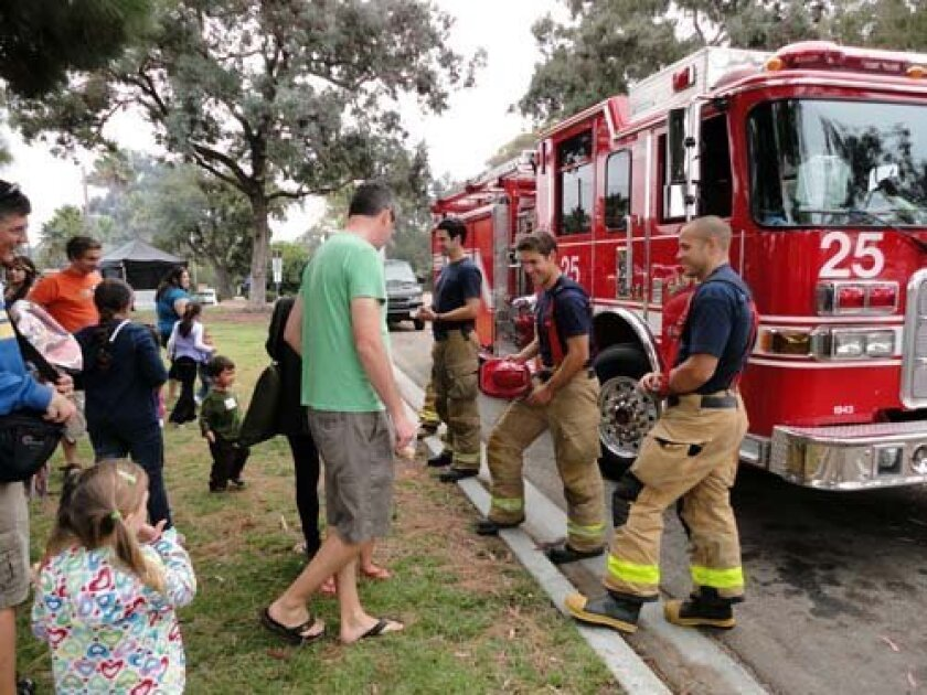 The 'Little Grads' meet some local firefighters and see a fire truck. Photo: UCSD