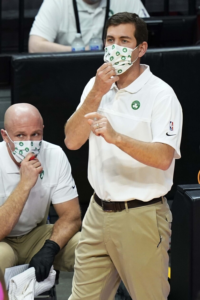 Boston Celtics head coach Brad Stevens gestures during the first half of an NBA basketball game against the Miami Heat, Wednesday, Jan. 6, 2021, in Miami. (AP Photo/Marta Lavandier)