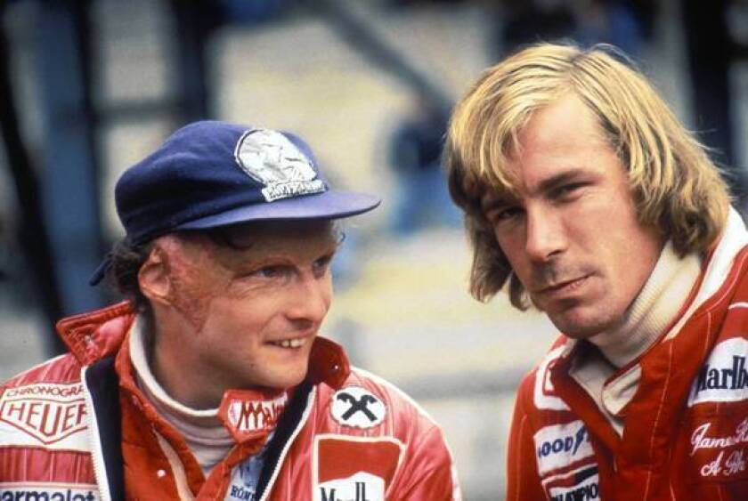 """Driver Niki Lauda of Austria, left, talks to rival James Hunt before the Belgian Grand Prix in 1977. His life is the basis of the film """"Rush."""""""
