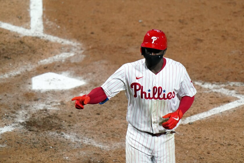Philadelphia Phillies' Didi Gregorius reacts after hitting a two-run home run off New York Mets pitcher Rick Porcello during the fifth inning of a baseball game, Tuesday, Sept. 15, 2020, in Philadelphia. (AP Photo/Matt Slocum)