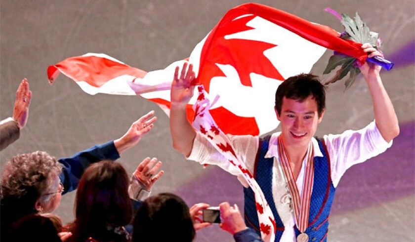 Patrick Chan celebrates his gold medal in the men's free skating program during the 2013 ISU World Figure Skating Championships.