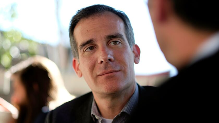 L.A. Mayor Eric Garcetti speaks with constituents in the Larchmont neighborhood on Jan. 28.