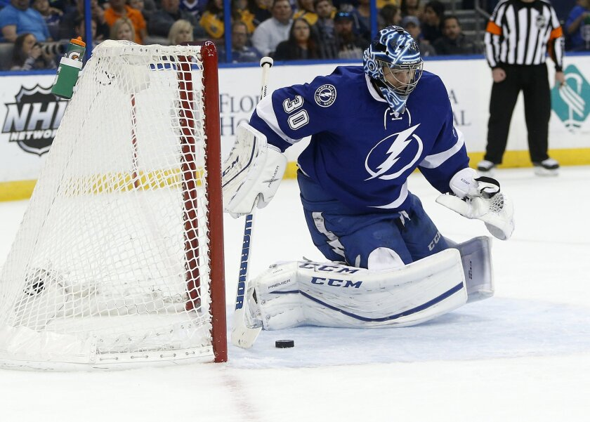 Tampa Bay Lightning goalie Ben Bishop (30) defends the goal from a shot during the first period of an NHL hockey game against the Nashville Predators, Friday, Feb. 12, 2016, in Tampa, Fla. (AP Photo/Brian Blanco)