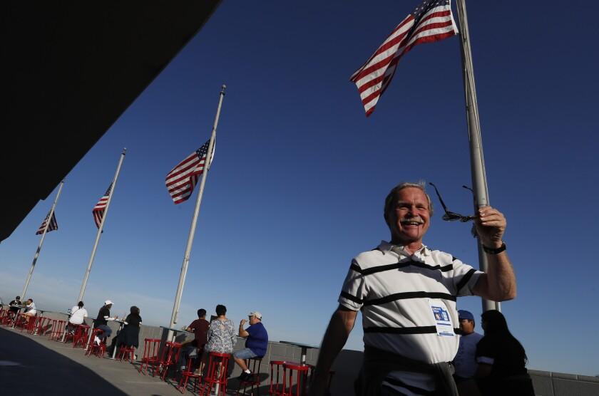 Los Angeles Times columnist Chris Erskine walks around the top deck of Dodger Stadium