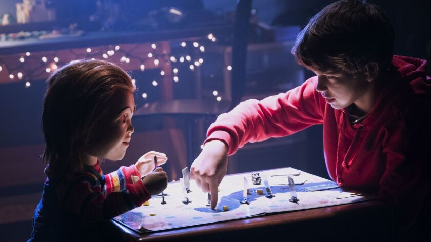 This image released by Orion Pictures shows the character Chucky, left, and Gabriel Bateman in a sce