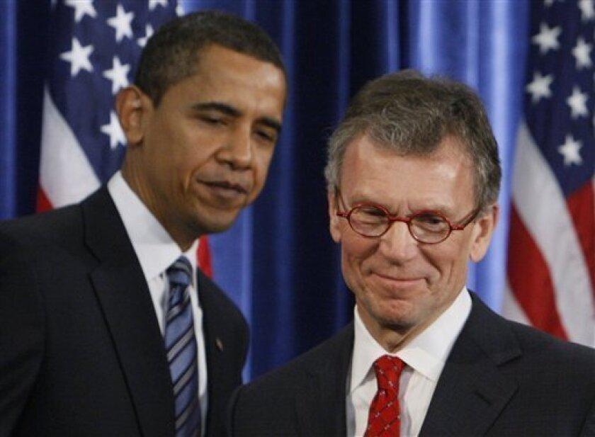 President-elect Barack Obama stands with Health and Human Services Secretary-designate, former Senate Majority Leader Thomas Daschle, at a news conference in Chicago, Thursday, Dec. 11, 2008. (AP Photo/Charles Dharapak)