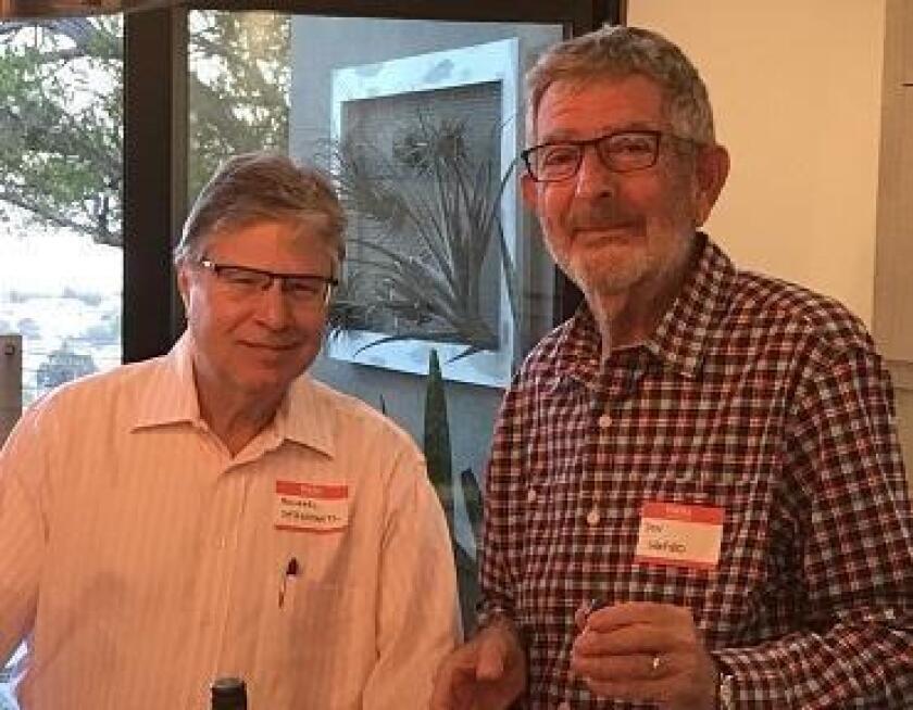 La Jolla Newscomers Club members Michael Dershowitz and Don Shapiro attend a social gathering.