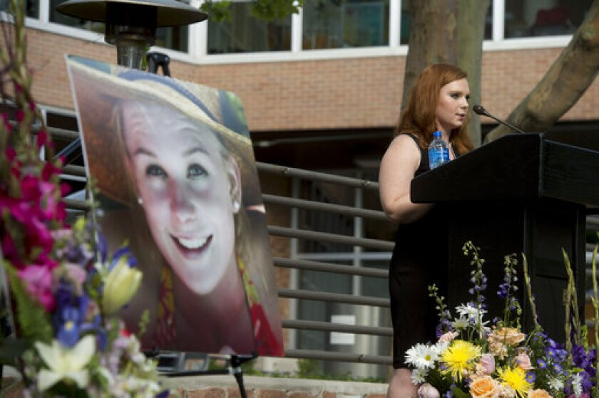 FILE - In this July 1, 2019, file photo, Ashley Fine speaks during a vigil for Mackenzie Lueck at the university in Salt Lake City. A tech worker pleaded guilty Wednesday, Oct. 7, 2020, in the death of Lueck, more than a year after her disappearance sparked a large-scale search that ended with the discovery of her charred remains in his backyard. Ayoola A. Ajayi is expected to be sentenced to life in prison without the possibility of parole. (Jeremy Harmon/The Salt Lake Tribune via AP, File)