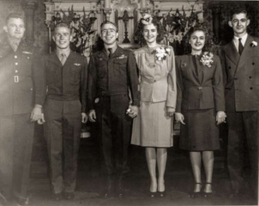 (Center) Joseph Stolmeier and Mary Jo Petersen wedding portrait just after World War II in 1945, with siblings Esther Petersen and Harold Petersen (on right).<br>