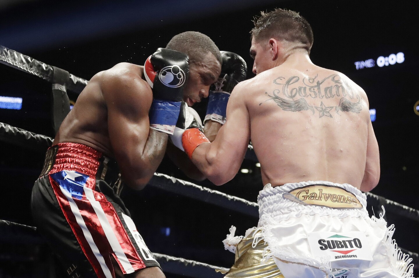 Argentina's Brian Carlos Castano , right, punches Cuba's Erislandy Lara during the eighth round of a WBA super welterweight championship boxing match Saturday, March 2, 2019, in New York.(AP Photo/Frank Franklin II)