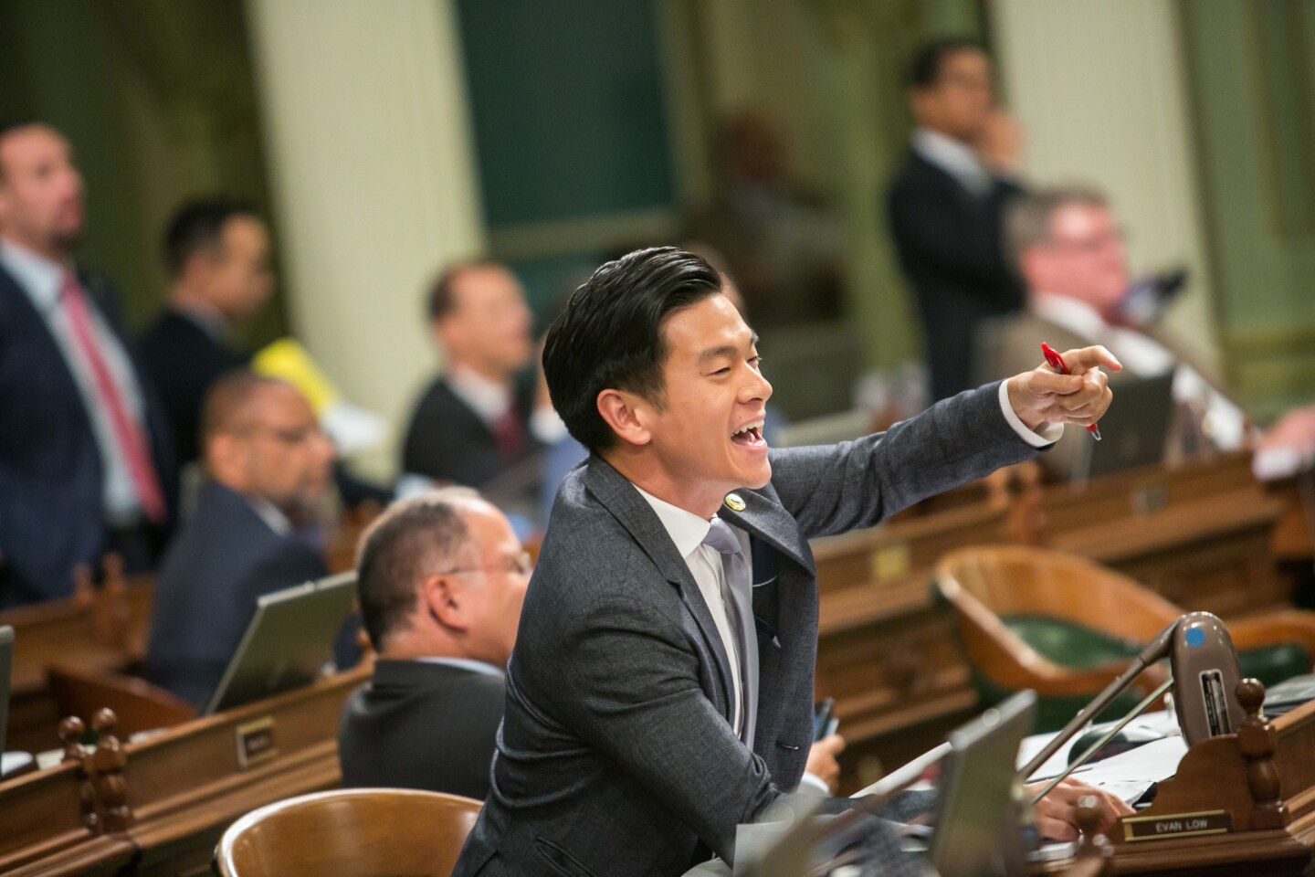 Assemblyman Evan Low (D-Campbell) jeers fellow lawmakers as they race to vote on bills on the last day of the legislative year in Sacramento.