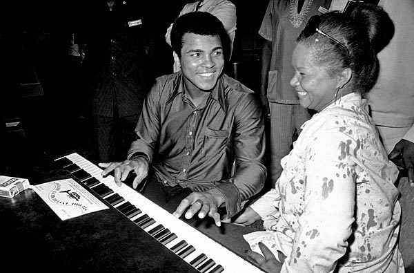 Muhammad Ali chats with Etta James at the piano at the Kinshasa Hotel in Zaire in September 1974. James and other African American musicians were in the country to perform at the Zaire 74 music festival. The concert was organized as a promotional event to coincide with the heavyweight championship boxing match between Ali and George Foreman.